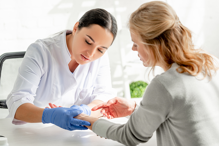 Woman getting a check up at a skin cancer clinic in Melbourne