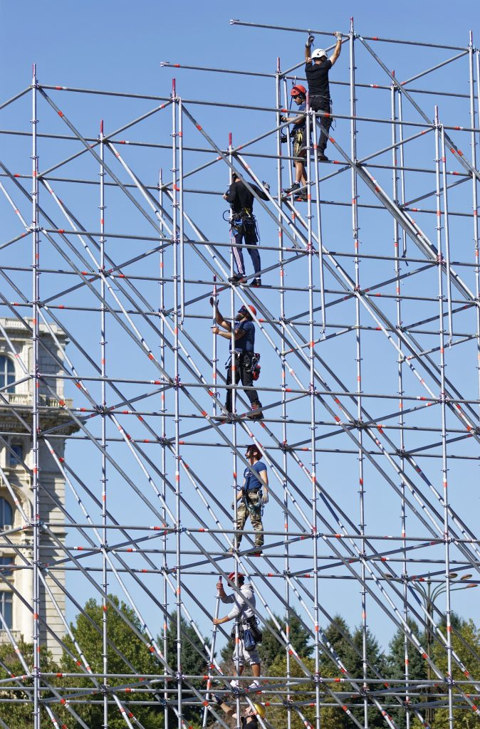 Workers standing on scaffolding