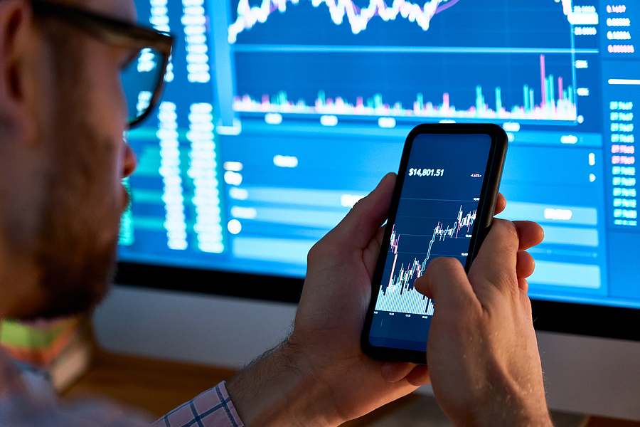 Businessman trader looks at the Australian stock report